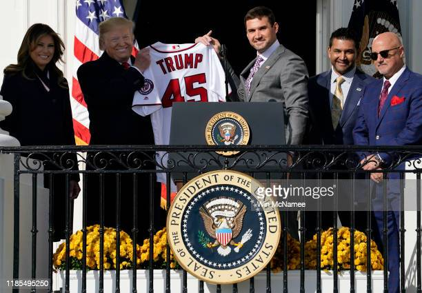 First baseman Ryan Zimmerman presents a Nationals jersey to U.S. President Donald Trump as he Trump welcomes the 2019 World Series Champions, the...