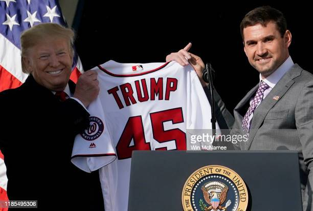 First baseman Ryan Zimmerman presents a Nationals jersey to US President Donald Trump as Trump welcomes the 2019 World Series Champions the...