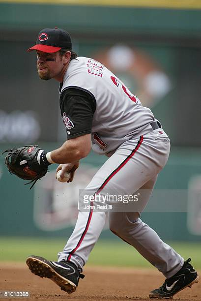 First baseman Sean Casey of the Cincinnati Reds eyes the pitcher as he looks to toss the ball underhand during the MLB game against the Cleveland...