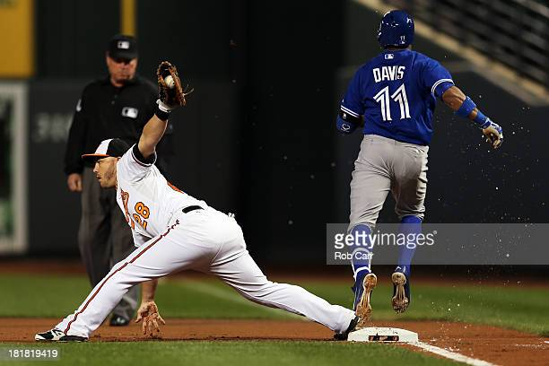 First baseman Steve Pearce of the Baltimore Orioles forces out Rajai Davis of the Toronto Blue Jays for the third out of the first inning at Oriole...