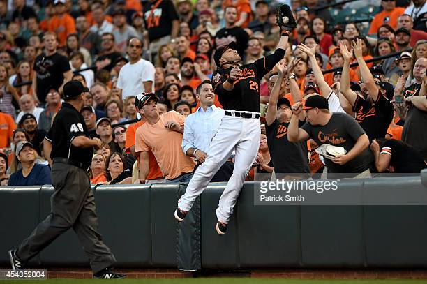 First baseman Steve Pearce of the Baltimore Orioles makes a catch on a hit by Trevor Plouffe of the Minnesota Twins in the second inning at Oriole...
