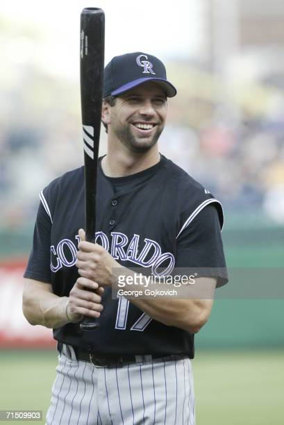 First baseman Todd Helton of the Colorado Rockies smiles while talking with fans before a game against the Pittsburgh Pirates at PNC Park on July 18...