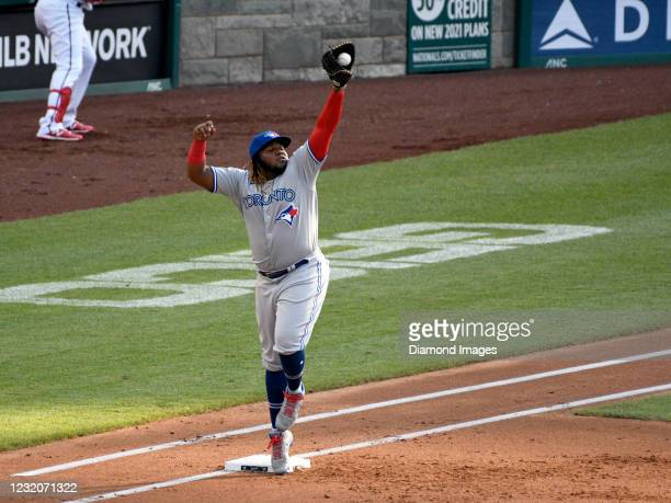 First baseman Vladimir Guerrero, Jr. Of the Toronto Blue Jays catches a throw during a game against the Washington Nationals at Nationals Park on...
