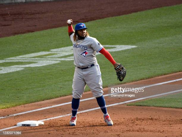 First baseman Vladimir Guerrero, Jr. Of the Toronto Blue Jays throws toward second base during a game against the Washington Nationals at Nationals...