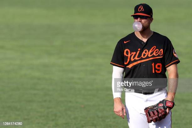First basemen Chris Davis of the Baltimore Orioles blows a bubble during the third inning against the Miami Marlins during game one of a doubleheader...