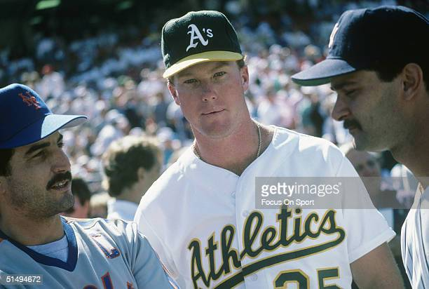 First basemen Keith Hernandez of the New York Mets Mark McGwire of the Oakland Athletics and Don Mattingly of the New York Yankees talk shop during...