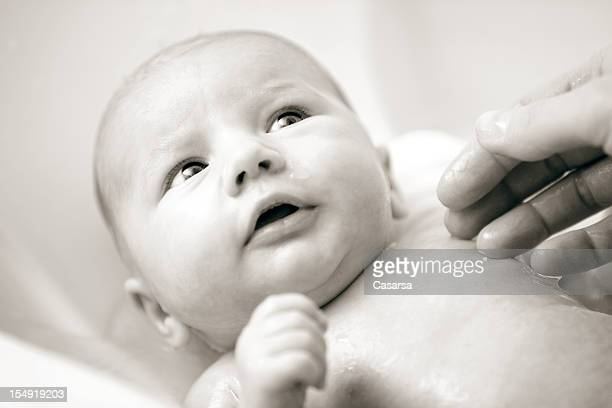 first bath - baby bathtub stock photos and pictures