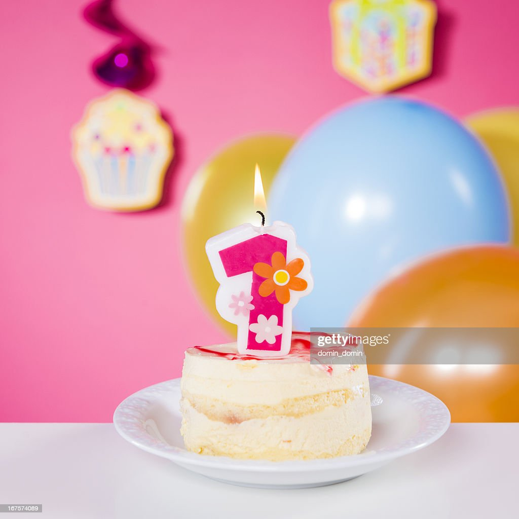 First Birthday Candle With Animals Stock Photo: First Birthday Birthday Cake With One Candle On Table Pink