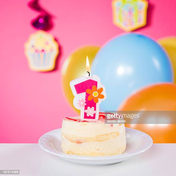 First Birthday, birthday cake with one candle on table, pink