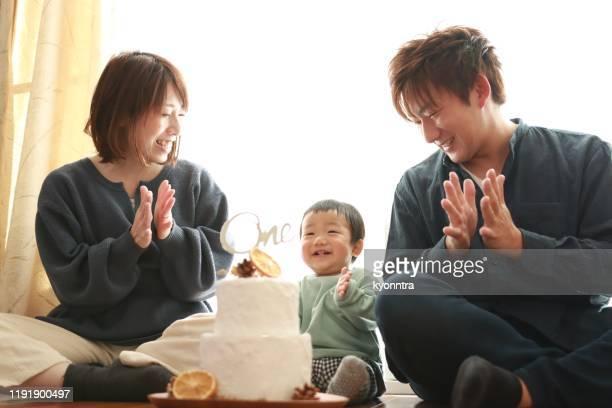 first birthday for asian baby - first birthday imagens e fotografias de stock