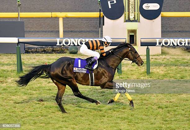 First choice Kitasan Black ridden by Yutaka Take crosses the finish line to win the Japan Cup at Tokyo Racecourse in Fuchu Tokyo on Nov 27 2016