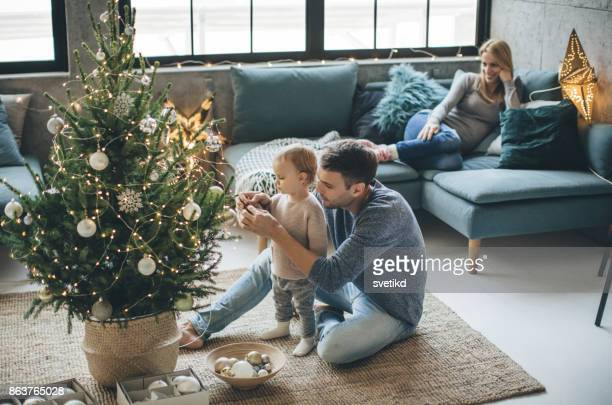 first christmas as a family - christmas stock pictures, royalty-free photos & images