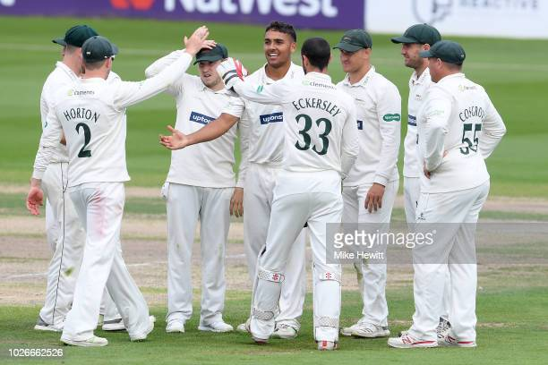 First class debutant Ben Mike of Leicestershire celebrates with team mates after dismissing David Wiese of Sussex to claim his 3rd wicket during the...