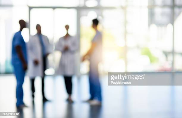 first class medical team - medical building stock pictures, royalty-free photos & images