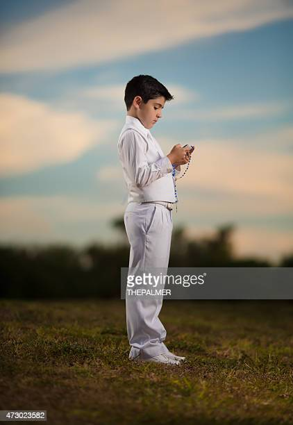 First communion boy with Bible