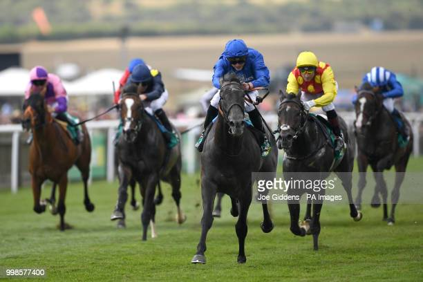 First Contact ridden by James Doyle wins the bet365 Mile Handicap during day three of The Moet Chandon July Festival at Newmarket Racecourse