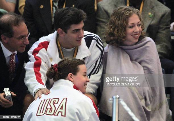 US first daughter Chelsea Clinton watches the Olympic Women's individual foil fencing preliminaries 21 Septemebr 2000 with foil fighter Ann Marsh and...
