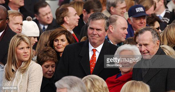 First daughter Jenna Bush left looks on as Florida Governor Jeb Bush former First Lady Barbara Bush and former US President George HW Bush pose for a...