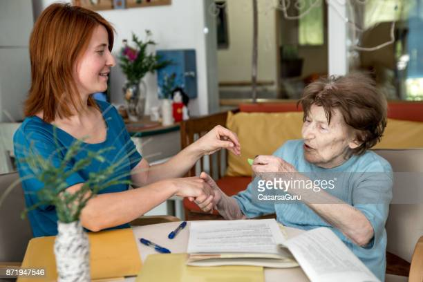 first day at retirement home - residential care stock photos and pictures