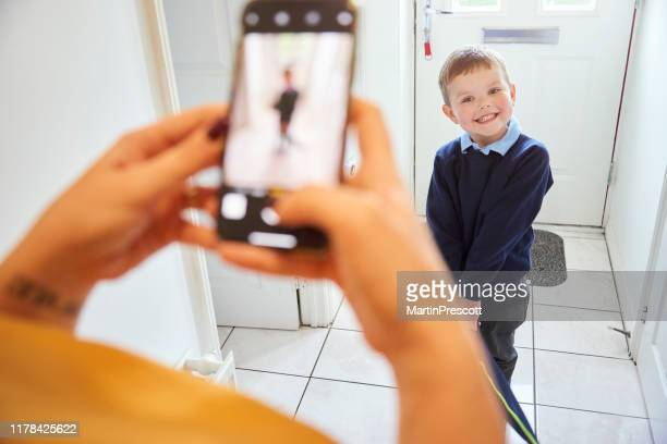 first day at school picture for smiling toddler - shoulder bag stock pictures, royalty-free photos & images