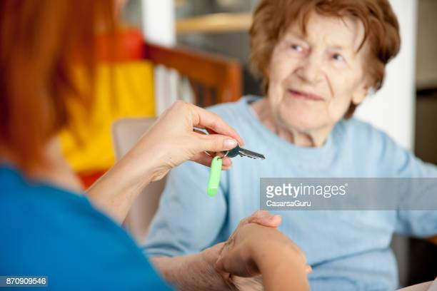 first day at the nursing home - residential care stock photos and pictures