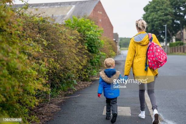 first day back at school - rear view stock pictures, royalty-free photos & images