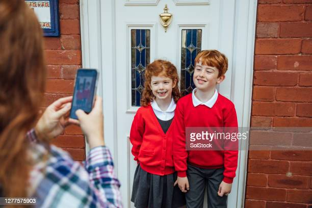 first day back at school - school uniform stock pictures, royalty-free photos & images