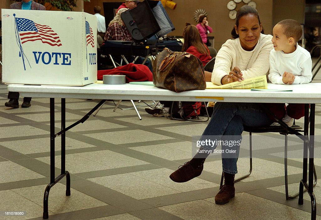 DENVER, CO, OCT. 23, 2006- First day for early voting in Denver at the Wellington E. Webb Municipal Office Building in downtown Denver. Katrina Boykin<cq> uses her four-year-old son Terry's<cq> day off from pre-school as a civic lesson. She explained to h : News Photo