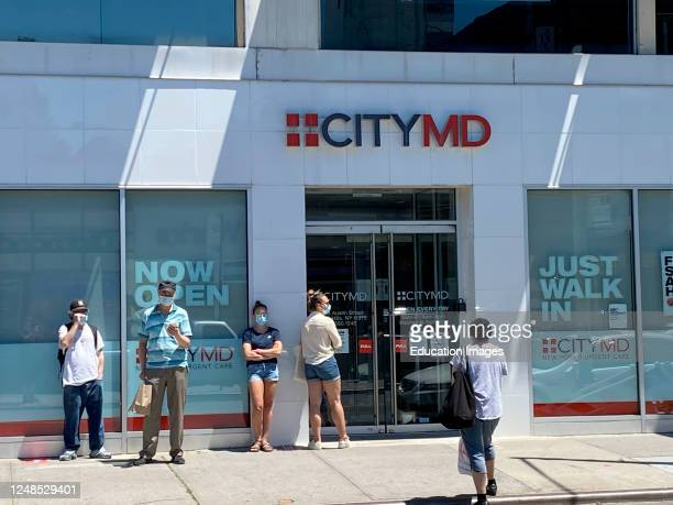 First day of Phase 1, reopen the City, after Coronavirus, Line outside CityMD, walk-in doctors office, Forest Hills, Queens, New York.