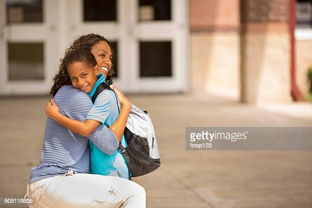 First day of school.  Little boy hugs mom goodbye.