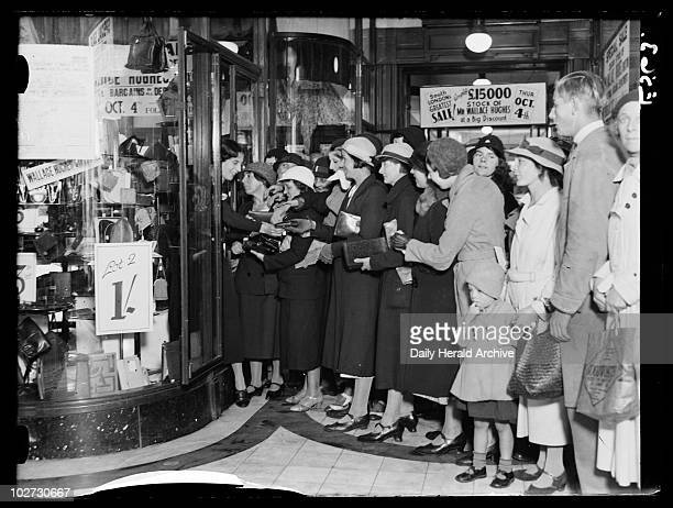 First day of the sales in Quin Axtens Brixton October 1934 A photograph of a long queue of eager shoppers waiting outside Quin Axtens shop in Brixton...
