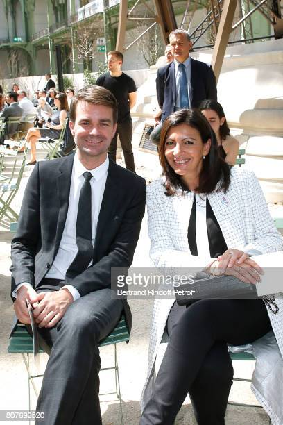 First Deputy Mayor of Paris responsible for culture Bruno Julliard and Mayor of Paris Anne Hidalgo attend the Chanel Haute Couture Fall/Winter...