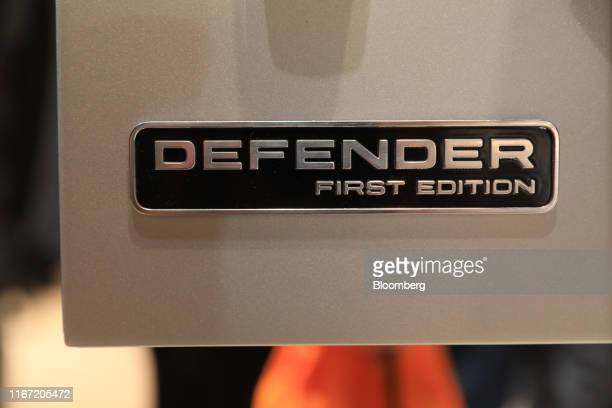 A 'First Edition' badge sits on a front door of a new Land Rover Defender sports utility vehicle manufactured by Jaguar Land Rover Plc on the opening...