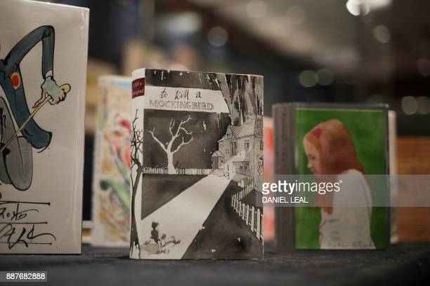A first edition of Lee Harper's book 'To Kill a Mockingbird' with a dustjacket designed by George Butler is seen on display at Sotheby's action house...