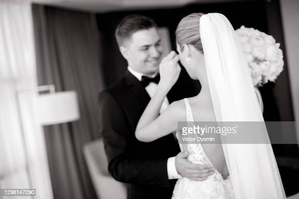 first emotional meeting of the happy newlyweds - marriage stock pictures, royalty-free photos & images