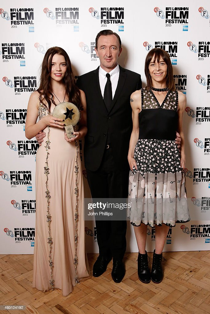 First Feature Competition winners actors Anya Taylor-Joy, Ralph Ineson and Kate Dickie pose with the Sutherland Award for the film 'The Witch' at the BFI London Film Festival Awards at Banqueting House on October 17, 2015 in London, England.
