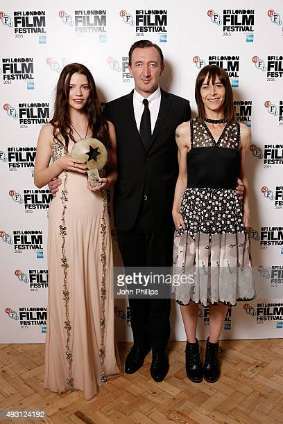 First Feature Competition winners actors Anya TaylorJoy Ralph Ineson and Kate Dickie pose with the Sutherland Award for the film 'The Witch' at the...