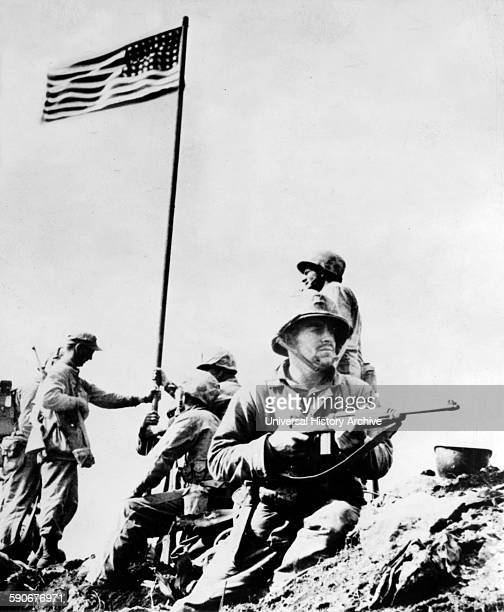 First flag set atop Mt. Suribachi, 23 February 1945, during World war Two United States Marine Corps photograph taken by Staff Sergeant Louis R....