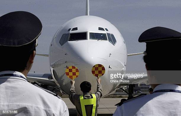 First flight of Okay Airways arrives at Kunming Wujiaba Airport on March 11 2005 in Kunming of Yunnan Province China Okay Airways is the country's...
