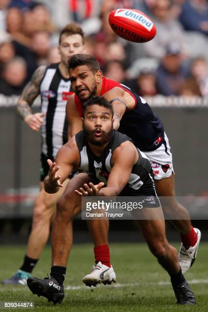 First gamer Kayle Kirby of the Magpies dives for the mark during the round 23 AFL match between the Collingwood Magpies and the Melbourne Demons at...