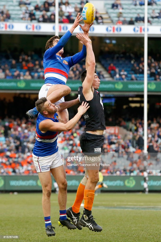 First gamer Lewis Young of the Bulldogs marks the ball during the round 17 AFL match between the Carlton Blues and the Western Bulldogs at Melbourne Cricket Ground on July 16, 2017 in Melbourne, Australia.
