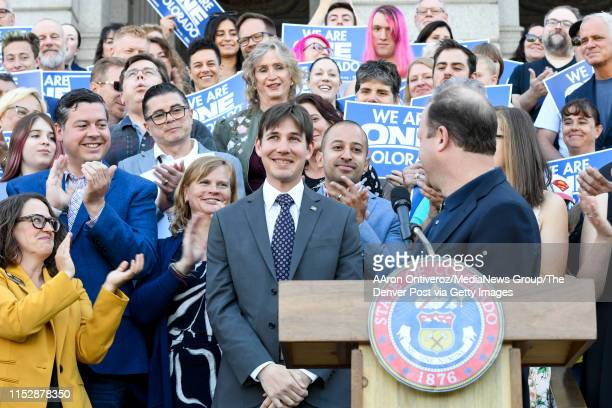 First gentleman Marlon Reis is applauded by partner Gov Jared Polis and supporters during a signing for two LGBTQ bills on Friday May 31 2019 One...