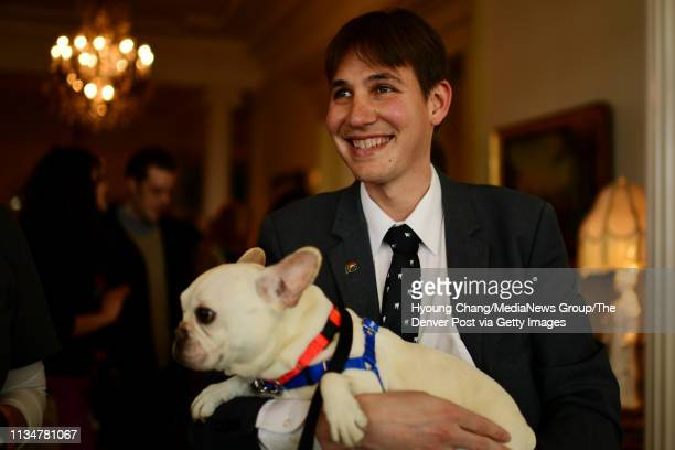 First Gentleman Marlon Reis meets 4 years old French Bulldog Hemi from Denver Animal Shelter at Governor's Mansion on Saturday March 9 2019 Reis...
