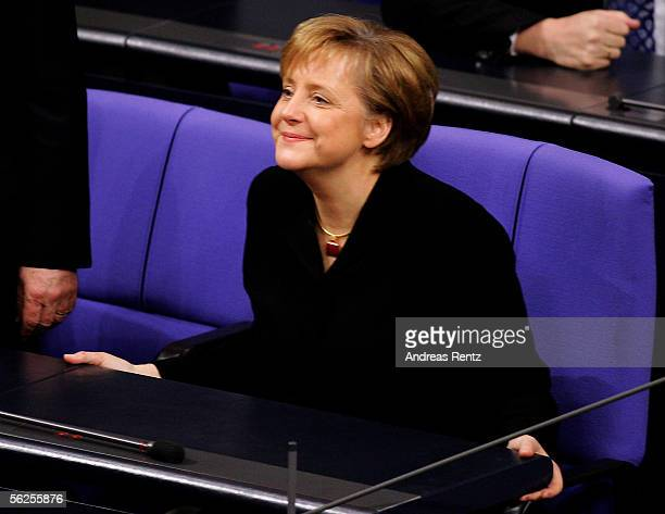 First German female Chancellor Angela Merkel of the Christian Democratic Union smiles as she takes sits at the chancellor chair for the first time at...