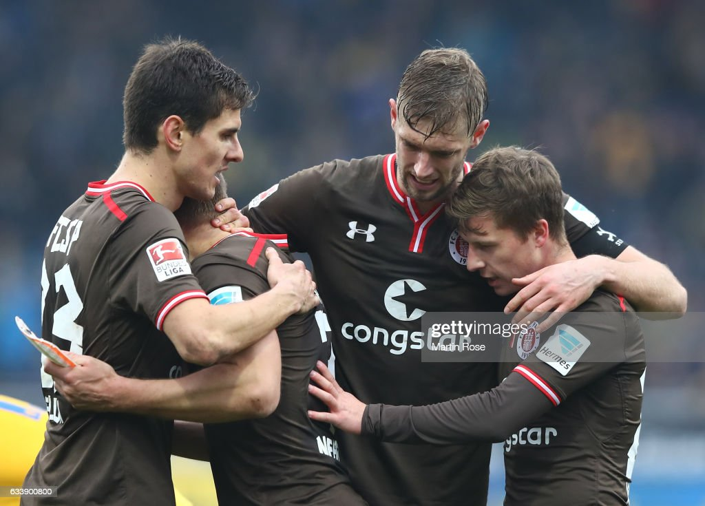 First goal scorer Lasse Sobiech of St. Pauli celebrates with teamates at the end of the Second Bundesliga match between Eintracht Braunschweig and FC St. Pauli at Eintracht Stadion on February 5, 2017 in Braunschweig, Germany.