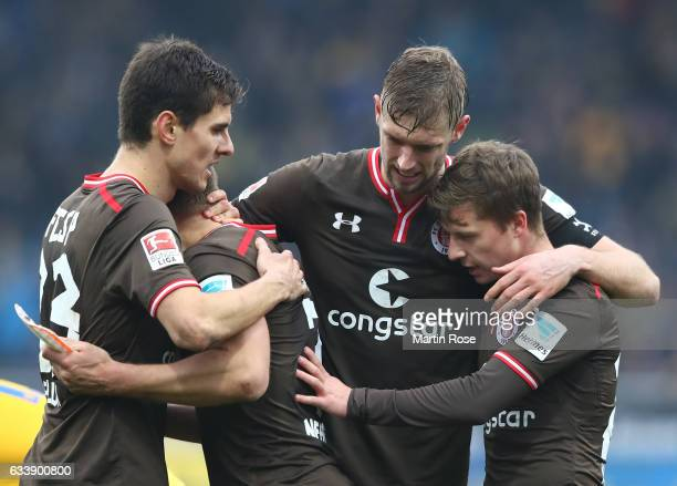 First goal scorer Lasse Sobiech of St Pauli celebrates with teamates at the end of the Second Bundesliga match between Eintracht Braunschweig and FC...