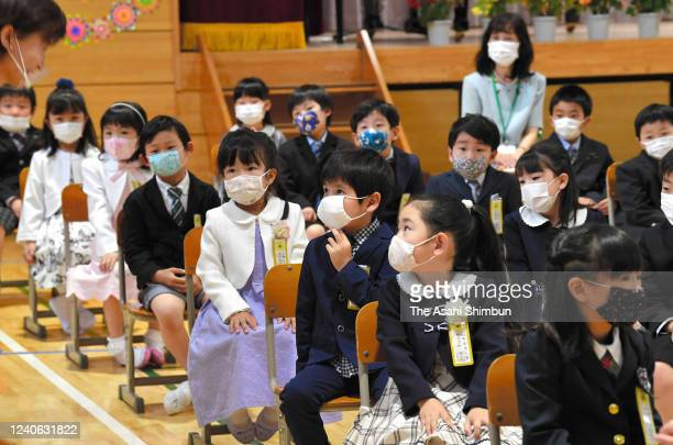 First grade pupils attend the welcome ceremony which was supposed to be held in April after the state of emergency for coronavirus had been...