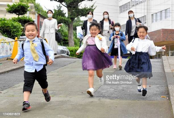First grade pupils run after the welcome ceremony which was supposed to be held in April after the state of emergency for coronavirus had been...
