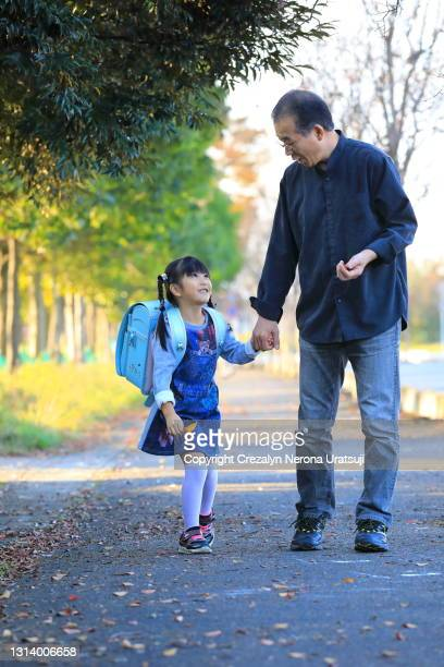 first grade student with school bag and her father walking - saitama prefecture stock pictures, royalty-free photos & images