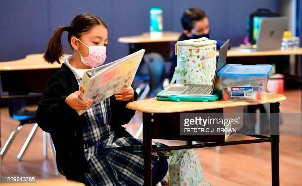 First grade students prepare for class at St. Joseph Catholic School in La Puente, California on November 16 where pre-kindergarten to Second Grade...